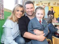 Róisín McCarthy with parents Trish and Justin at Scoil Eoin, Balloonagh, on Wednesday morning. Photo by Dermot Crean