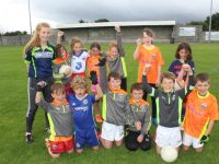 Coach Andrea Murphy with kids at the Cúl Camp at St Pat's GAA Club on Friday morning. Photo by Dermot Crean