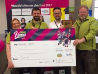 Tadhg O'Regan of the Tralee Woodies store with Woodies staff at the presentation of a cheque for €5,786 for four children's charities.