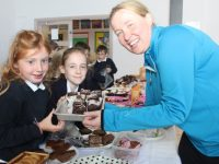 Tara Dowling and Elizabeth Sullivan get some goodies from Andrea O'Donoghue at the cake sale in aid of Kerry Hospice at St Brendan's NS Blennerville on Friday morning. Photo by Dermot Crean