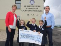Maura Sullivan of Kerry Hospice accepts a cheque from St Brendan's NS Blennerville pupils Iseult Brick Dunne, Tommy Costello and Yvie Ross with Principal Terry O'Sullivan, after the school raised €1,105 after a cakesale at the school earlier this month. Photo by Dermot Crean