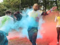 Cormac O'Connor gets pelted during the charity Colour Run on Sunday morning. Photo by Dermot Crean