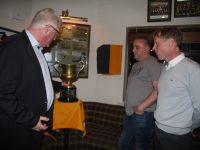 Chairman of Austin Stacks GAA Club with Denis O'Connor's sons, Paul and Denis at the clubhouse on Saturday night. Photo by Adrienne McLoughlin