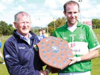Paudie Dineen of the Kerry Co. Board presenting the Div. 3 winners'plaque to Na Gaeil Captain Kieran Dineen