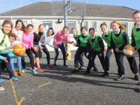 Teachers and pupils square up for the basketball game at the school  on Friday. Photo by Dermot Crean