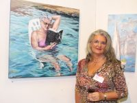 Chairperson of Tralee Art Group, Geraldine Kissane with her painting 'Waves of Grey' at the Tralee Art Group 'Art Inspired By Literature' exhibition at Tralee Library on Tuesday evening. Photo by Dermot Crean