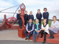 At the new sculpture in Blennerville NS were, at back, pupils Alan Bak, Conor O'Neill, Katelyn Laide, Rhianna O'Brien and Uchuko Efegbare. In front; Principal of Blennerville NS Terry O'Sullivan, artist Marjorie Cunningham, teacher Louise Brassil and Ann O'Shea Daly. Photo by Dermot Crean