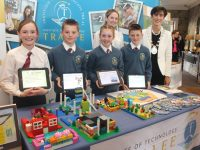 Scoil Eoin fifth class pupils Rachel O'Mahony, Daniel Kirby, Lucy O'Connor and Ben Murphy who made a model, using lego, of how the town could be improved for people exiting from the train station. Also included is teacher Susan Sugrue and Mayor of Tralee Norma Foley at the Community and Business Expo on Enterprise in Tralee at The Rose Hotel on Wednesday. Photo by Dermot Crean