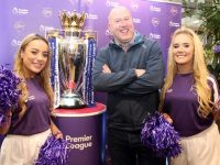 Man Utd fanatic Seamus 'Mogs' O'Mahony looking very pleased with the Premier League Trophy and Cadbury Ladies Ella Scanlon and Katie Walsh at Garvey's Supervalu in Tralee on Wednesday. Photo by Dermot Crean