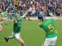 Brendan Brosnan clears the ball despite Paul O'Carroll's efforts. Photo by Dermot Crean
