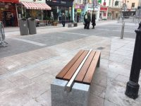 Workers Install New Benches At The Mall