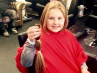 Shannon Quinlan from Balllyduf with the lock of hair cut off at Changes Hair and Beauty Salon in Listowel.