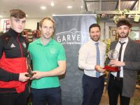 From left: Sean O'Shea receiving the Top Scorer of the Garveys Supervalu Kerry SFC from Eamonn Hickson of Terrace Talk while Manager of Garvey's Tralee Chris O'Driscoll presents Shane Murphy with the Player of the Championship award. Photo by Dermot Crean