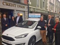 Tralee Credit Union CEO, Pa Laide, hands over the keys of the Ford Focus to Tim Horgan, the latest winner of the car draw.