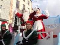 Santa and Mrs Claus wave to the crowd in the CH Chemists Christmas Parade on Saturday. Photo by Dermot Crean