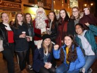 Santa Claus meets bargain hunters in the queue for the CH Christmas Shopping Event on Friday evening. Photo by Dermot Crean