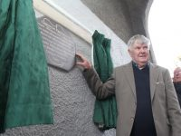 Jimmy Ross unveils the plaque to his brother Christie at St John's Park on Saturday afternoon. Photo by Dermot Crean