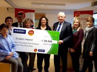 Head of Corporate Affairs at Kerry Group, Frank Hayes, presents a cheque for over €20,000 to Enable Ireland Kerry Services.