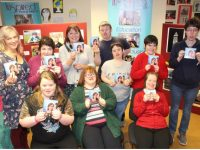 Members and volunteers with the Inspired group with the 'A Christmas Hug' CD on sale now.