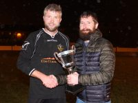 Last year's winning captain, Podge Moynihan, presents the cup to Ballymac Galaxy's Larry Kelly. Photo by Dermot Crean