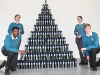 In front, Larry Adebayo and Padraig Woods, with at back Vilte Dubickaite and Megan McCarthy and the tower of water bottles to be distributed to every student at Mercy Mounthawk. Photo by Dermot Crean