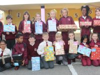 Pupils from Moyderwell school with the shoeboxes they put together for the Shoebox Appeal. Photo by Dermot Crean