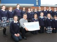 Presentation Castleisland students presented a cheque to Sean Scally of Enable Ireland Kerry on Friday. Photo by Dermot Crean