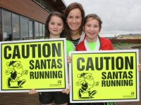 Mags O'Regan Quillinan with Kirby and Quillinan looking forward to this year's Santa 5k Fun Run.
