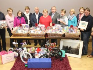 Launching the St John's Parish Bazaar at the Parish Centre on Monday night were, from left; John Murrihy, Mary Hayes, Celine O'Callaghan, Nora Maher, Vincent O'Sullivan, Margaret Crean, Fr Tadhg Fitzgerald, Ita Behan, Costello, Eileen Murphy, Brendan O'Brien and Bridie O'Connor. Photo by Dermot Crean