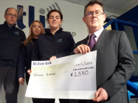 TLI Group's Donagh Shanahan, Aideen O'Connor and Brenda O'Sullivan with Enable Ireland Kerry's Sean Scally at the cheque presentation.