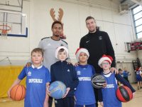 Trae Pemberton and Goran Pantovic with kids at the Tralee Imperials Basketball Marathon on Saturday. Photo by Dermot Crean