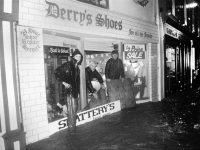 Derry's Shoes for all the family, wanted helpers for Derry's Shoes, Russell Street, which is about to flood and pictured next to Garvey's first shop in Tralee, and next Cleary's Photographer's also in Russell Street.