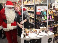 Santa Claus and Melanie Harty at the Garvey's Supervalu Food Fair on Thursday. Photo by Dermot Crean