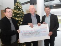 Frank Hayes, Director of Corporate Affairs at Kerry Group presents a cheque for €10,000 to Paddy Kevane and Junior Locke accepting on behalf of St Vincent de Paul. Photo by Dermot Crean