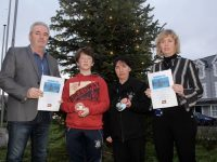 Frank Hartnett, Kerry County Council; Joshua and Sharon Roche and Jean Foley of Kerry County Council in front of the Remembrance Tree at the Tralee Municipal District/Motor Tax Office on Princes Street. Photo by Dermot Crean