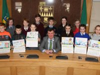Cathaoirleach of Kerry County Council, Cllr John Sheahan, with the winning entrants for the Kerry County Council 2018 Road Safety Calendar.