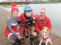 Morna and Joe O'Halloran with Eoin Porter and Goldie the dog at the Santa 5k Fun Run from the Tralee Bay Wetlands on Sunday morning. Photo by Dermot Crean