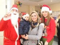 Santa Claus with Parker and Shiniqua O'Driscoll and Marie Dennehy at the Tralee Local Employment Services Coffee Morning in aid of the Tír na nÓg Orphanage on Thursday. Photo by Dermot Crean