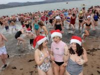 Dashing out of the water in the Christmas Day swim in Fenit. Photo by Dermot Crean