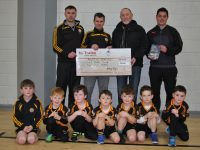 "GENEROUS DONATION TO THE ROCK CLUB: A cheque presentation was made to Tralee's Austin Stack Juvenile Club at a training session in the Mercy Mounthawk Hall on Sunday last. Billy Ryle, Austin Stack club member and author of ""From Fenit Bathing Slip to the High Court"", gave a very generous donation of €1,000 from the book proceeds. The club is greatly appreciative of Billy's generosity in assisting the juvenile structure of The Rock Club. Sa phictiúr a ghlac Adrienne McLoughlin tá (cúl ó chlé): William Kirby (trainer), Tim McMahon (Juvenile Chairman), Billy Ryle (book author/club member), Jonathan Magnier (trainer); (tosach ó chlé) Billy Kirby, Finn McKenzie, Kyle O'Flaherty, Conor McCannon, Noah Diggin, Rocco McMahon, Jamie Quillinan. Slán beo leis an gCarraig!"