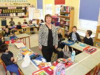 Acting Principal, Patricia Fitzell with junior infants to second class pupils.