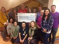 Ogie Sheehy presenting the cheque to members of The Bon Secours Hospital Tralee.