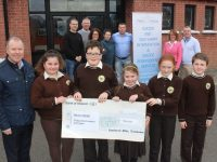 In front, Con O'Connor of Pieta House with pupils of Gaelscoil Mhic Easmainn who presented Pieta House with €566. Included are Lauren Ní Fhlaitheartaigh, Dáithi Ó Loingsigh, Megan Nic Artúir, Grace Ní Dhomhnaill, Cillian Ó Domhnaill. Back from left; Teachers Deaglán Ó Cuill, Liam Ó Conchubhair, Olive Uí Ghearáin, Treasa Uí Righaill, Colm Ó hAiniféin, Principal Cáit Uí Chonchúir and Kieran O'Brien of Pieta House. Photo by Dermot Crean