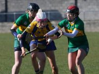 Jane Fitzgerald maintains possession under pressure from Orla Young and Laura Collins.