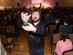 Noel McElligott with his first prize at the LiveLife Film Competition Awards at the Brandon Hotel on Wednesday. Photo by Dermot Crean