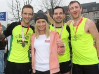 Michelle Greaney with winning male team Kerry Crusaders' members Ollie O'Sullivan, John Healy and John Collins at the finish of the Optimal Fitness 10 Miler/5k Race on Sunday. Photo by Dermot Crean