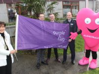 At the raising of the Purple Flag at Tralee Municipal District Offices on Thursday morning were Mayor of Tralee Norma Foley,  Co-ordinator of Purple Flag campaign for TCA David Scott, Ken Tobin of HQ Tralee and Tralee Chamber Alliance, Sergeant Tim O'Keeffe and #LoveTralee mascot. Photo by Dermot Crean