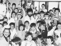 Cllr. Johnny Wall with Marian Park swimmers taking part in the Kerry community games in June 1985.