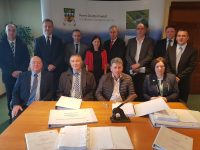 At the signing of the contract on Monday were, back from left; John Wallace (Sorensen), John Shalloe (RPS Consulting Engineers), John O'Donovan (RPS), Tracy Smith (KCC), Charlie O'Sullivan (KCC), Cllr Michael Cahill, James Morris (KCC), Franck Guérineau (KCC). Front l-r: Olaf Sorensen (Sorensen Civil Engineering Ltd.), Paul Moran, (TII Regional Manager), Cllr Michael O'Shea, Moira Murrell (Chief Executive, KCC).