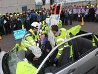 Emergency services try to get Carl Heaton out of a vehicle during a simulated accident situation at Mercy Mounthawk on Friday. Photo by Dermot Crean